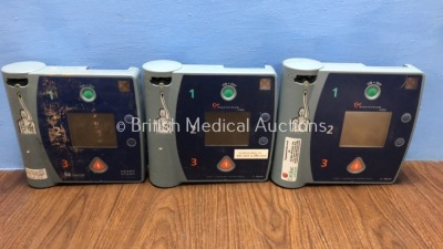 Job Lot Including 2 x Agilent FR2 Defibrillators (Both Power Up, 1 with Damaged Screen - See Photo) and 1 x Laerdal Heartstart Defibrillator (Powers U