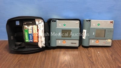 1 x Laerdal Heartstart FR and 1 x Hewlett Packard Heartstream Semi Automatic Defibrillators with 1 x Battery and 1 x Carry Case (Both Power Up and Pas