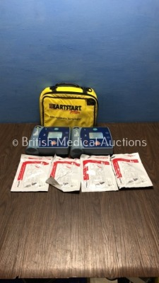 1 x Philips Heartstart FR2+ Defibrillator with 1 x Battery and 2 x Electrodes and 1 x Laerdal HeartStart FR2+ Defibrillator with 1 x Battery,2 x Elect