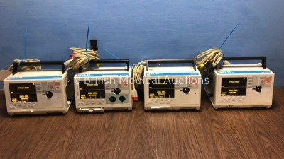 4 x Zoll M Series Defibrillators Including 1 x Pacer and 4 x ECG Options with 4 x Paddle Leads, 4 x 3 Lead ECG Leads and 4 x Batteries (All Power Up)