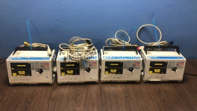 4 x Zoll M Series Defibrillators with EGG Option with 4 x Paddle Leads, 4 x 3 Lead ECG Leads and 4 x Batteries (All Power Up When Plugged in to Mains)