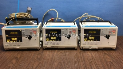 3 x Zoll M Series Defibrillators Including ECG Options with 3 x Paddle Leads, 1 x 3 Lead ECG Lead and 3 x Batteries (All Power Up) *S/N T07B87713 / T0