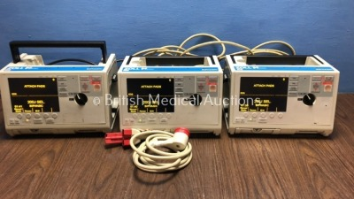 3 x Zoll M Series Defibrillators Including ECG Options with 3 x Paddle Leads (All Power Up with 1 x Missing MFC Cable - See Photo) *S/NT06H2366 / TO7I