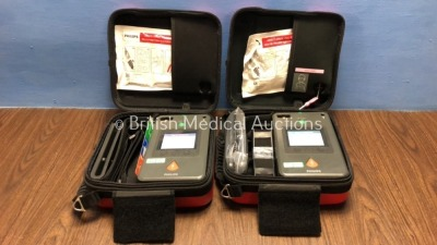 2 x Philips Heartstart FR3 Defibrillators with Batteries - Install Dates 2023-04 / 2022-07 in Cases, 1 with Marks -See Photo (Both Power Up) *C15C-010