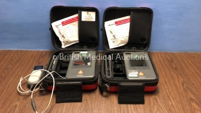 2 x Philips Heartstart FR3 Defibrillators in Cases with 1 x QCPR Meter (Both Power Up with Stock Battery - Not Included) *C16E-01077 / C14L-01596*