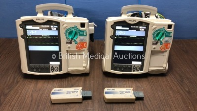 2 x Philips Heartstart MRx Defibrillators Including Pacer, ECG and Printer Options with 2 x Philips M3539A Batteries, 2 x Philips M3538 Module, 2 x Pa
