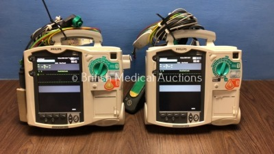 2 x Philips Heartstart MRx Defibrillators Including Pacer, ECG and Printer Option with 2 x Philips M3539A Batteries, 2 x Philips M3538 Module, 2 x Pad