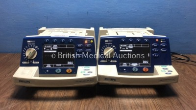 2 x Philips HeartStart XL Smart Biphasic Defibrillators with Pacer,ECG and Printer Options (Both Power Up) * SN US00451211 / US00594782 *