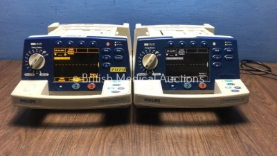 2 x Philips HeartStart XL Smart Biphasic Defibrillators with Pacer,ECG and Printer Options (Both Power Up) * SN US00445251 / US00122002 *