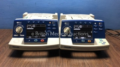 2 x Philips HeartStart XL Smart Biphasic Defibrillators with Pacer,ECG and Printer Options (Both Power Up) * SN US00936709 / US00443835 *