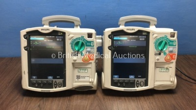 2 x Philips HeartStart MRx Defibrillators with BP1,BP2,NBP,ECG,SpO2,Temp and CO2 Options,2 x Modules and 2 x Batteries (Both Power Up-1 x Damage to Sc