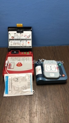 1 x CU Medical Systems iPAD Intelligent Public Access Defibrillator with Pads and Battery (Powers Up) and 1 x Philips Heartstart FRx Defibrillator wit