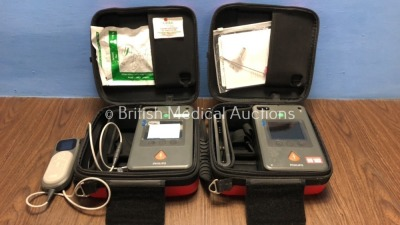 2 x Philips Heartstart FR3 Defibrillators in Cases with 1 x Battery and 1 x QCPR Meter (Both Power Up) *C16C-00106 / C13L-00518* (H)