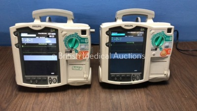 2 x Philips Heartstart MRx Defibrillators Including Pacer, ECG and Printer Options, with 2 x Philips M3539A Batteries, 2 x Philips M3538 Modules (Bot