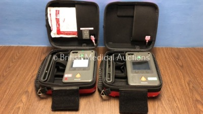 2 x Philips Heartstart FR3 Defibrillators in Cases with 1 x Battery (Both Power Up) *C14L-01566 / C13L-00528* (H)